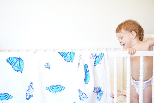 butterfly swaddle hanging on crib
