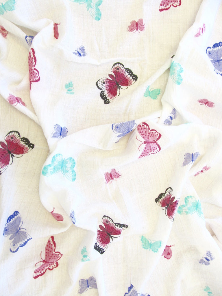 pink butterfly cotton swaddle up close