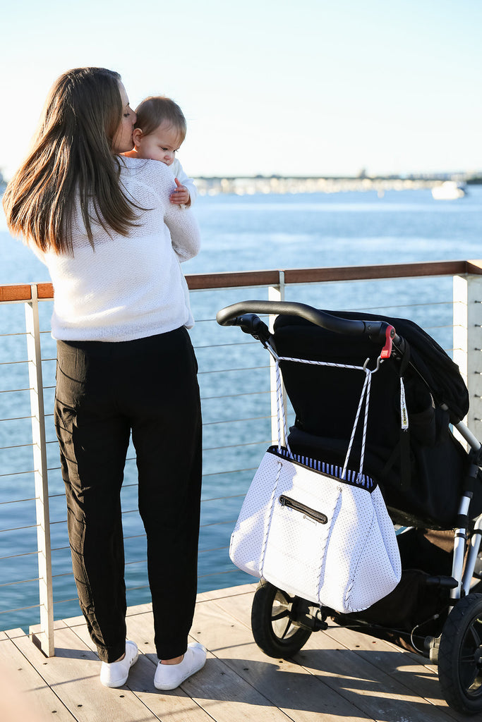 white diaper tote bag on pram