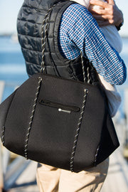 black neoprene tote on shoulder