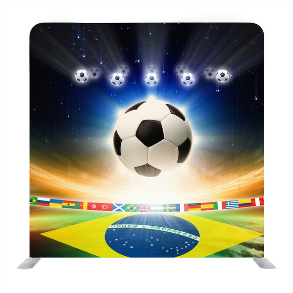Abstract sports background  soccer ball, Brazil flag, bright light, stars in night sky Media wall