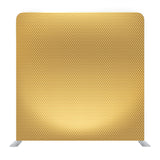 A close-up of golden fabric background texture backdrop