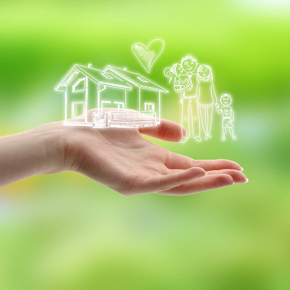 Female Hand with drawings of Family & House on Nature Background