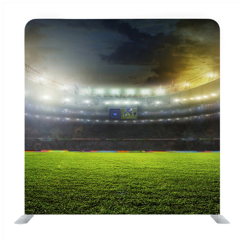 Green soccer field bright spotlights Media wall