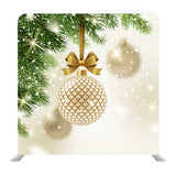 Patterned Golden Bauble With Glitter Gold Bow Hanging On A Christmas Tree Media Wall