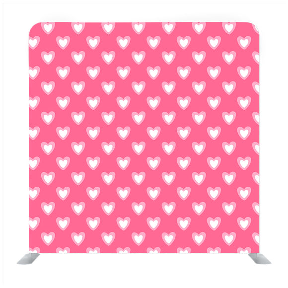 Pink background with white heart pattern media wall