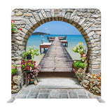 Seaview Through The Stone Arch With Flowers In Italy Background Media Wall