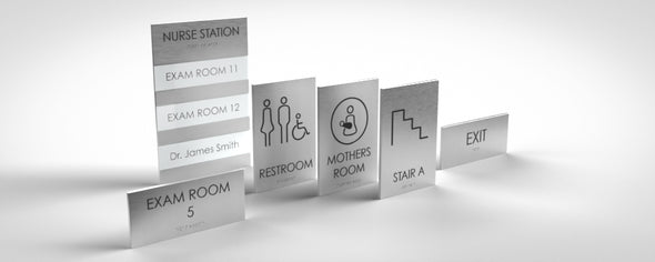 Noa Sign Family includes: Unisex Restroom, Women Restroom, Men Restroom, Room Name, Room ID, Suite Identification, Family Restroom, Elevator, Hall Exit, Room Number, Stair, Directory, Directional, Map Insert and Max Occupancy Signs.