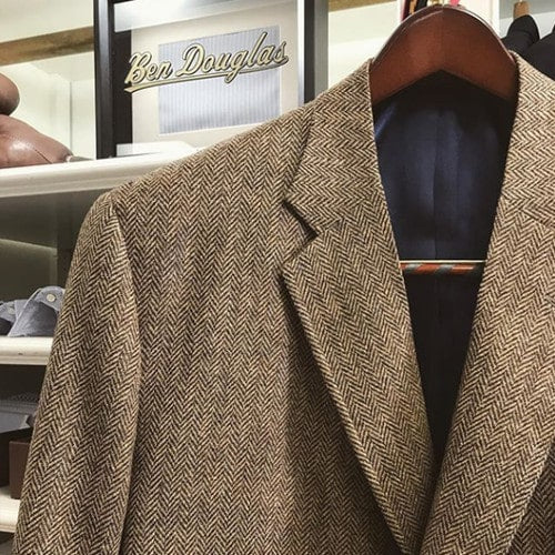 Custom tailored tan herringbone tweed sport coat with a natural shoulder