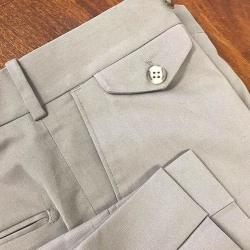 Custom tailored men's cotton khaki dress trousers with cuffs and watch pocket