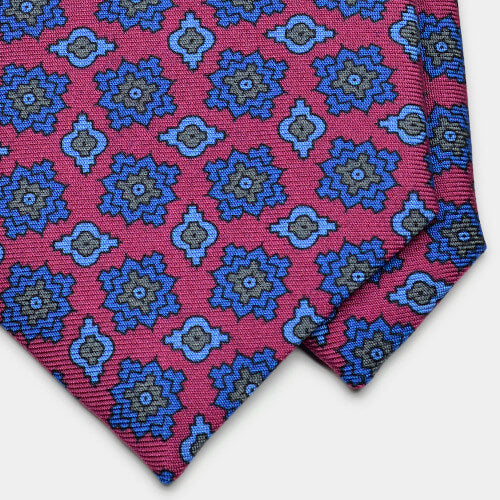 Close up detail of magenta foulard printed silk tie