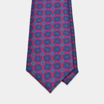 Vibrant magenta tie with blue and grey foulard pattern