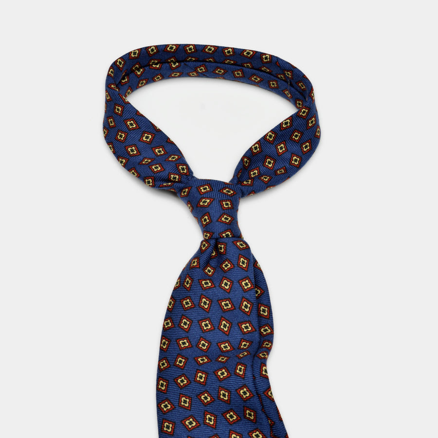 Navy wool challis tie tied in a knot