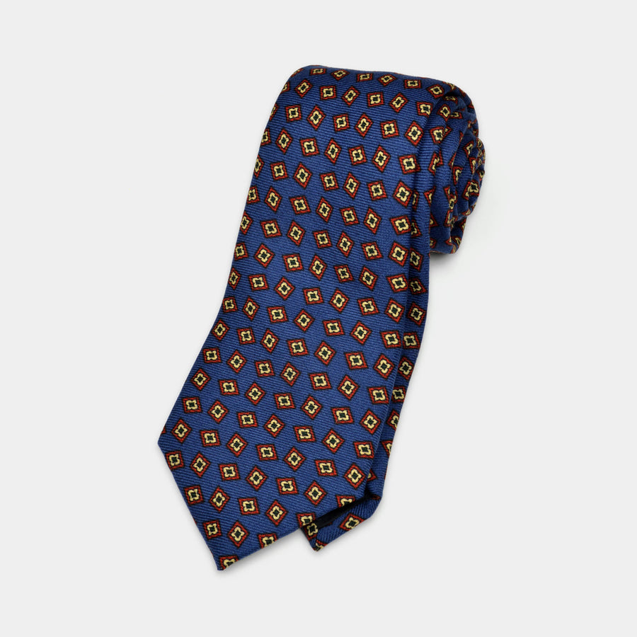 Navy foulard wool challis necktie rolled up