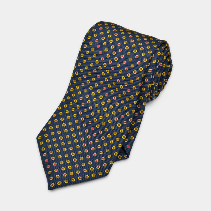 Navy floral neat patterned tie rolled up