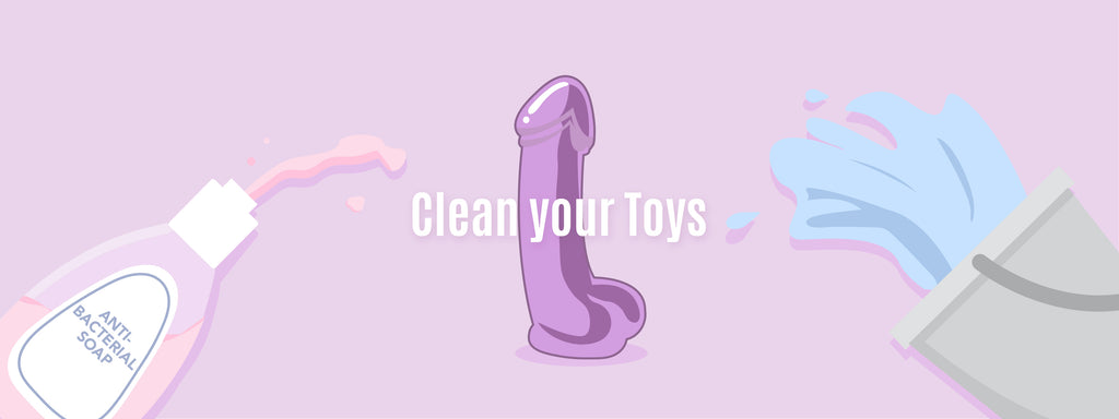 A purple sex toy displayed next to antibacterial soap, and a bucket of water.