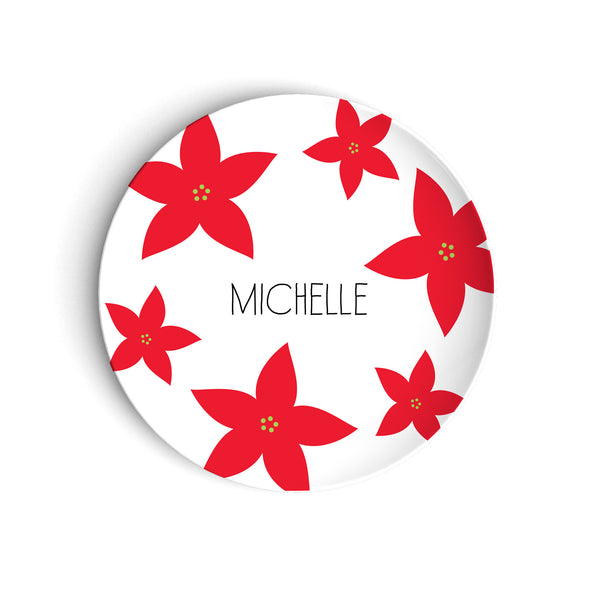 Red poinsettia flowers on holiday plate with custom name