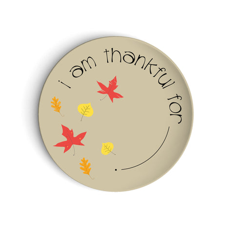 Tan plate with fall leaves saying I am Thankful For