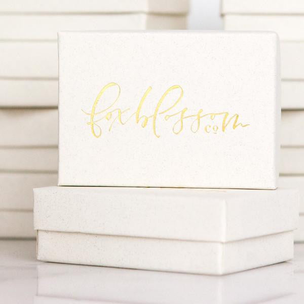 letterpressed gift packaging, gold foil boxes