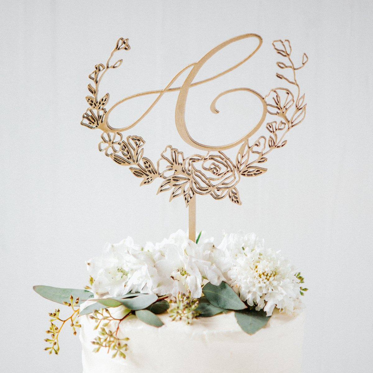 monogram cake toppers, personalized wedding cakes, statement cake toppers, laser cut topper, calligraphy initial cake toppers, floral cake topper