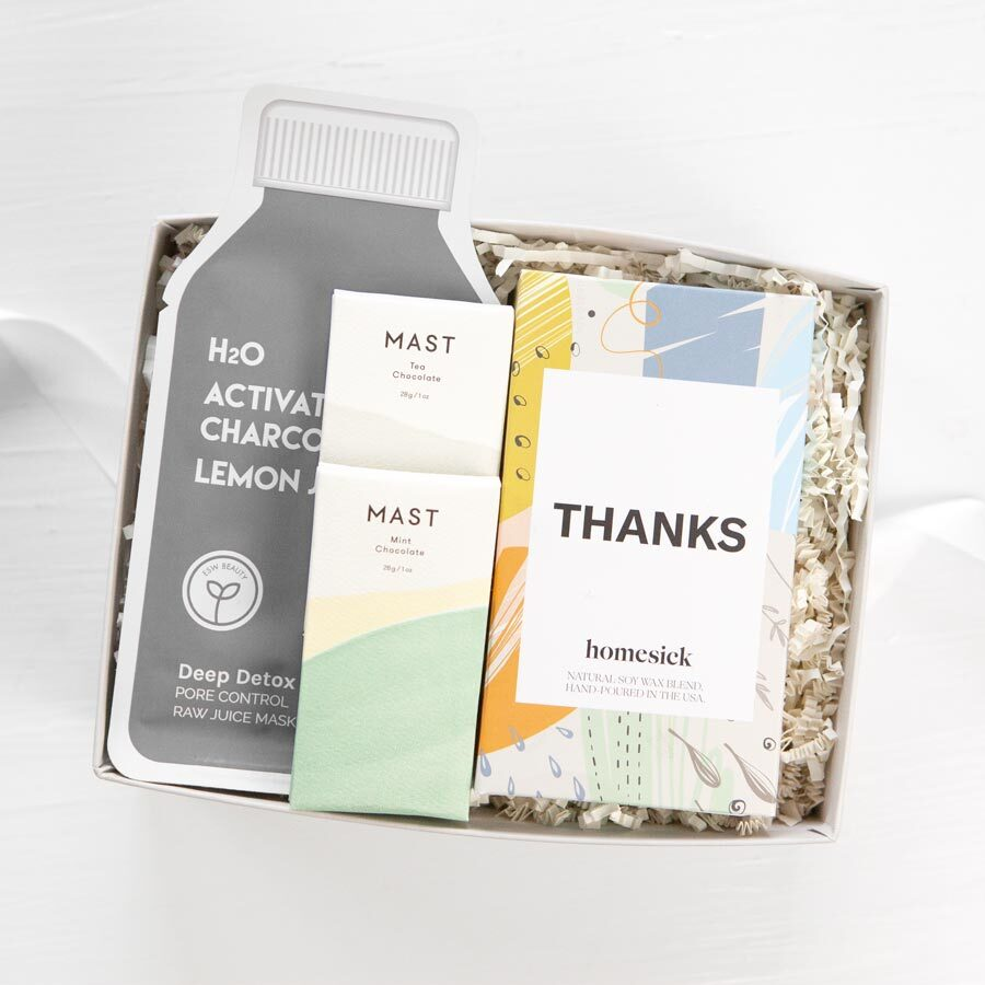 Nurses appreciation week gift box with thanks homesick candle, a MAST mini mint chocolate bar, a MAST mini tea chocolate bar, and an ESW Charcoal sheet mask.