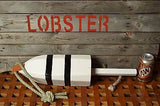 Maine Lobster Buoy in White with Black Stripes.