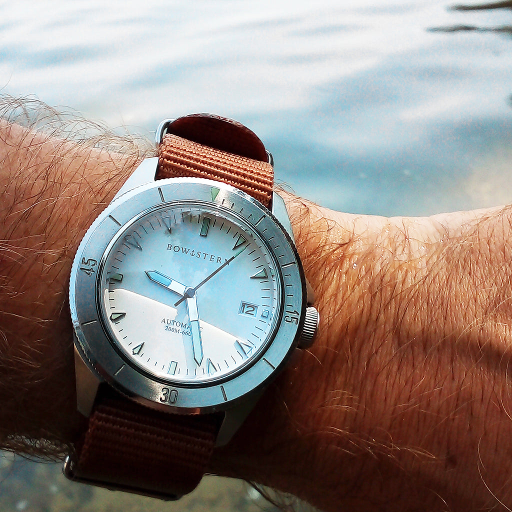 bow and stern silver abyss dive watch with camel tan nato strap