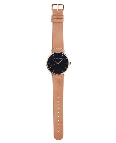 Catalina bow and stern watch. polished rose gold case, black dial, tan leather
