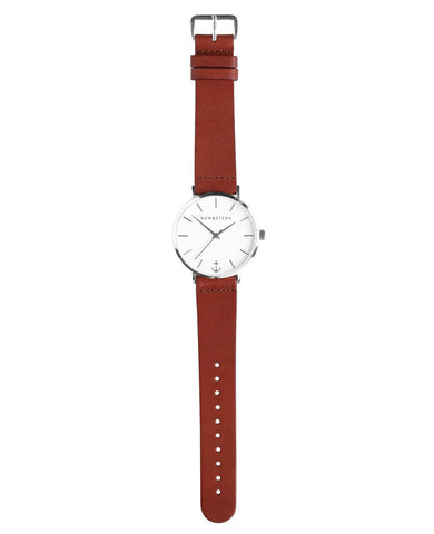 Havana bow and stern watch. polished silver case, white dial, brown leather