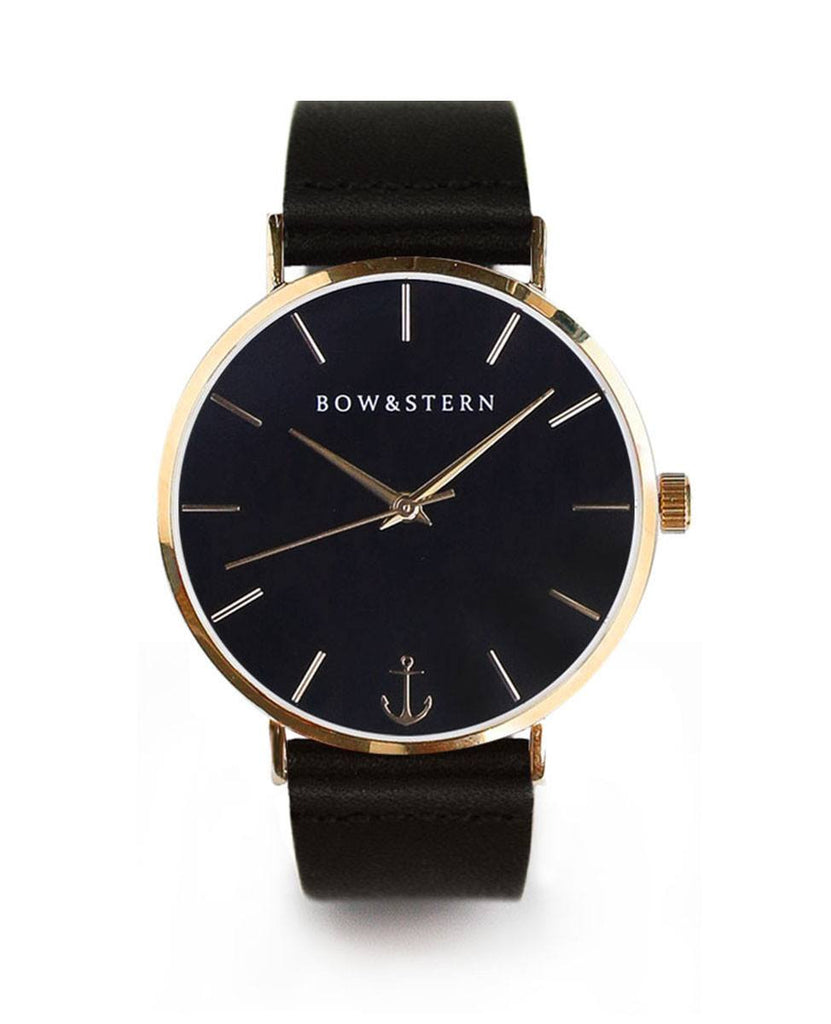 Monterey bow and stern watch. polished gold case, black dial, black leather