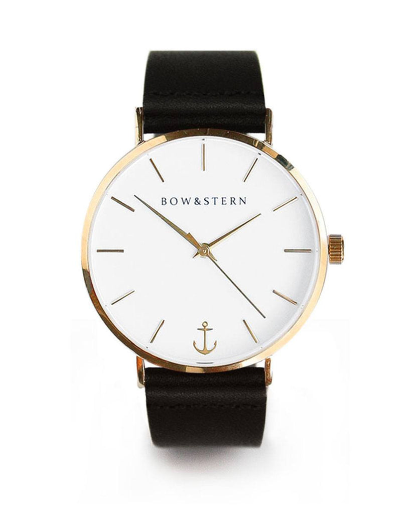 Pacifico bow and stern watch. polished gold case, white dial, black leather