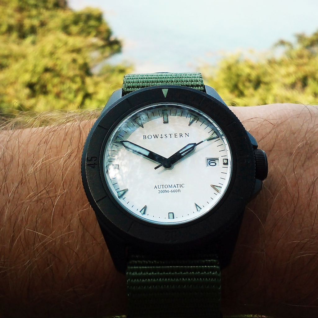 bow and stern black abyss dive watch with green nato strap