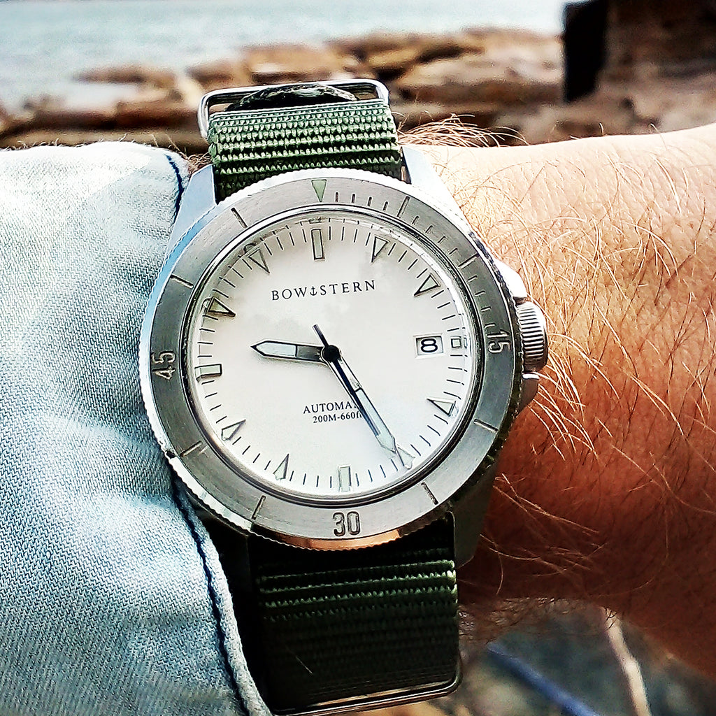 bow and stern - silver abyss dive watch with green nato strap