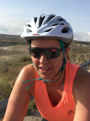 woman wearing sunglasses on bike