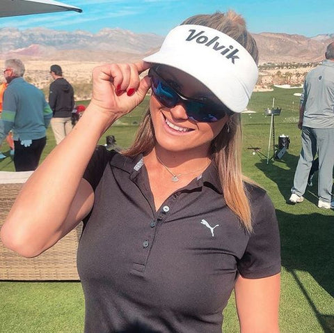 Carly Booth British Golf Professional wearing the Sol Invictus Sports Sunglasses