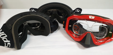 a view of a variety of ski googles with our prescription insets positioned inside the goggles