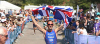 Yiannis GB triathlete finishing with UK union jack
