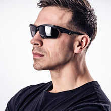 Load image into Gallery viewer, man wearing our sol invictus sunglasses