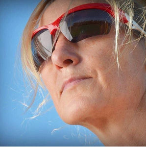 red and white sol invictus sunglasess worn by endurance runner