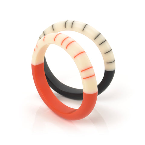 black and tangerine orange resin geometric bracelets  ornate with stripes