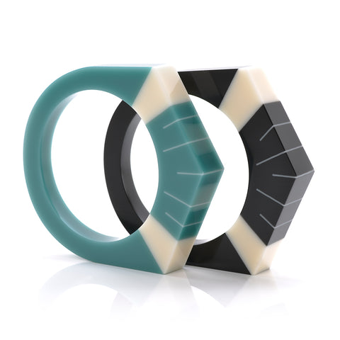 Art Deco resin bracelets in teal blue and black, inlaid with cream