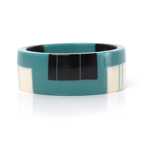 bakelite inspired teal cuff inlaid with black and white stripes