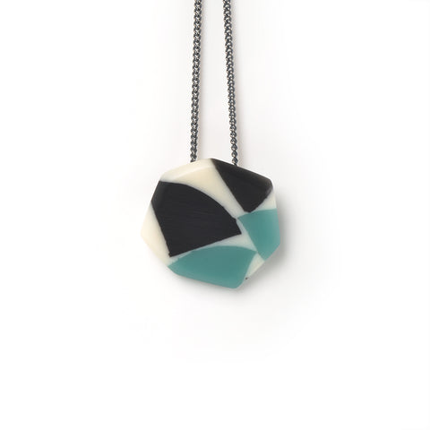 Multi coloured resin pendant hanging on oxidised Sterling silver chain. It is handmade from teal and black offcuts cast in Ivory White.