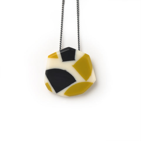 Resin pendant handmade from mustard green and black offcuts cast in Ivory White. Faceted  and hand sanded to a smooth finish, it hangs on oxidised Sterling silver chain. Comes wrapped in a Tiki printed pouch.