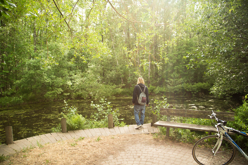 Picture of a Nordic bearded man gazing a pond in Viikki-Vanhankaupunginlahti, Helsinki nature sight