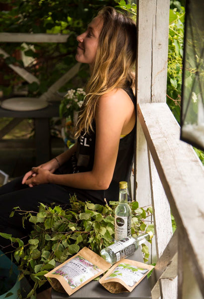 Picture of a Finnish woman chilling in a sauna terrace