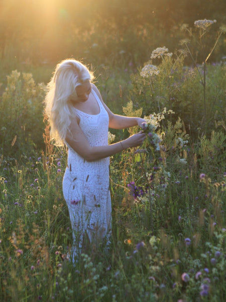 Picture of Annika foraging wild flowers under midnight sun