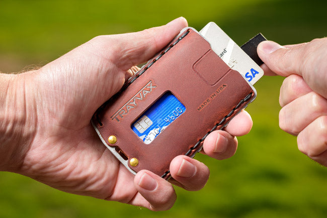 Ascent credit card holder with cards sliding out