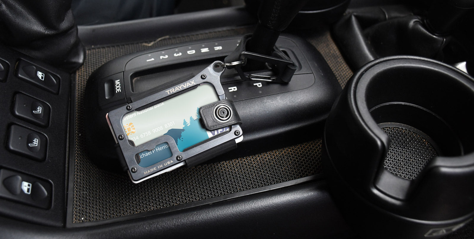 The Trayvax Contour wallet sitting inside of a truck.