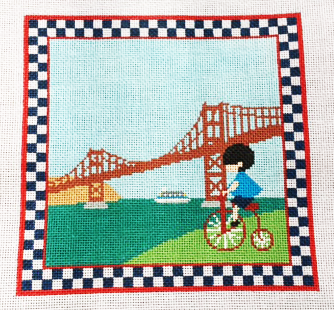 Boy Riding Bicycle by the Golden Gate Bridge